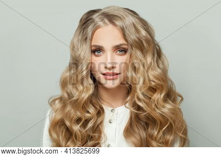 Young Pretty Woman With Healthy Blonde Curly Hairdo On White Background