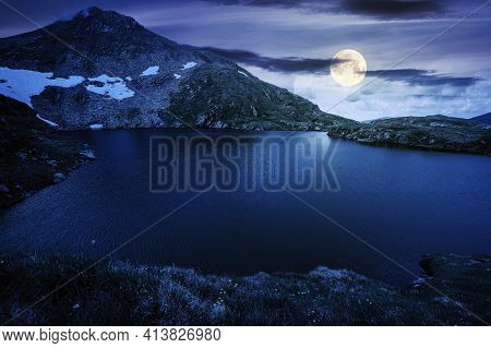 Summer Scenery With Lake On High Altitude At Night. Beautiful Landscape Of Fagaras Mountain Ridge In