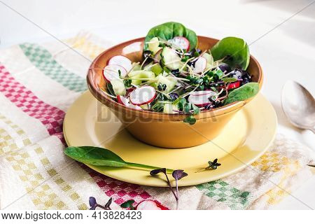 Spring Vegeterian Salad With Radish, Cucumber, Spinach And Microgreens