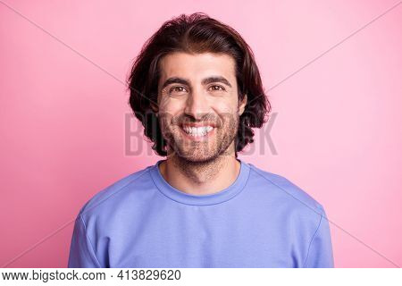 Photo Of Happy Positive Young Man Wear Purple Pullover Good Mood Smile Isolated On Pink Color Backgr