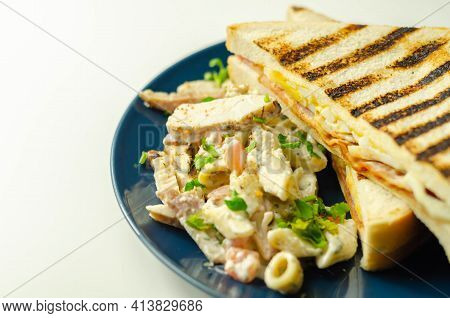 White Bread With Beechwood Smoked Bacon, Egg, Mayonnaise, And Tomato Served With Caesar Pasta With P