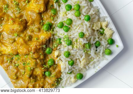 Chicken Curry With Egg Fried Rice, Chicken Breast Pieces In A Mildly Spiced Coconut Curry Sauce With