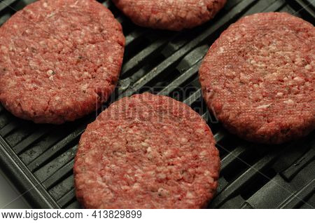 Seasoned Beef Burgers With A Pinch Of Salt And Black Pepper On The Grill, Cookout