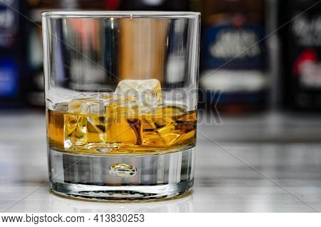 Old Fashioned Glass With Scotch Whisky And Ice Cubes On The Bar, Exclusive Drink