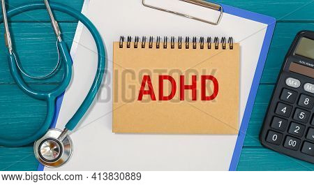Notepad With The Inscription Adhd - Attention Deficit Hyperactivity Disorder, And Stethoscope.