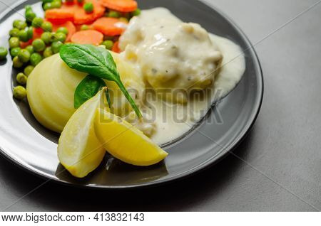 Cod Mornay, Flaky Cod With A Creamy Cheese Sauce, With Mashed Potato, Peas And Carrots, British Clas