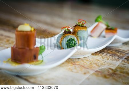 Cold Appetiser Platter: Pea Starch Noodle Rolls Filled Vegetable With Sesame Sauce And Xo Chili Sauc