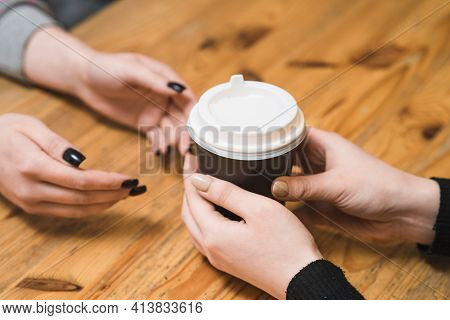 Barista Gives A Glass Of Coffee To A Guest In A Coffee Shop
