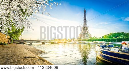 Paris Eiffel Tower Reflecting In River Seine Water At Sunrise In Paris, France. Eiffel Tower Is One
