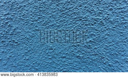 A Fragment Of A Wall Painted In Bright Blue. Painted Plaster, Concrete. Natural Volume And Light. Fr
