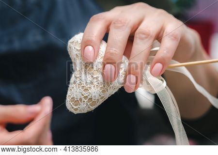 Well-groomed Female Hands With A Beautiful Pink Manicure And A Small Homemade Heart, Close Up