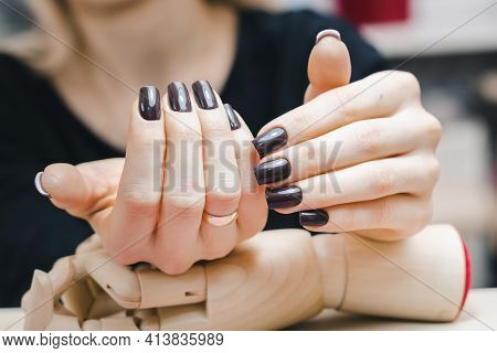 Well-groomed Female Hands With Beautiful Chocolate-colored Manicure, Close-up