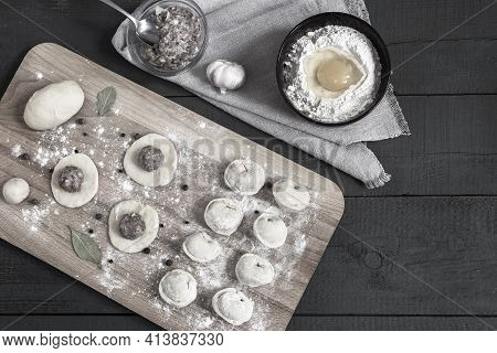 Cooking Homemade Dumplings, Russian Dumplings With Meat On A Wooden Table And Ingredients For Cookin