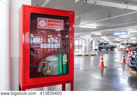 Fire Hose Reel Box In The Corner Of Car Parking., The White Thai Language Letter In The Middle Of Th