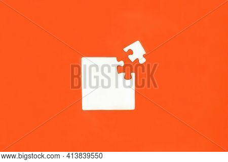 White Mosaic On An Orange Background. Puzzle. Teamwork. Business Processes