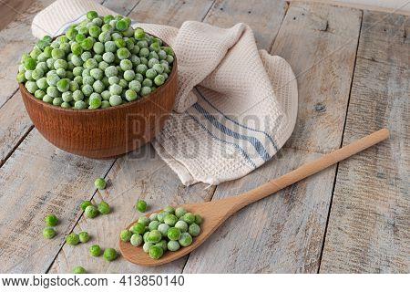 Young Frozen Green Peas On Wooden Table Viewed From Above. Green Pea Pod Table Peas. Closeup Of Fres