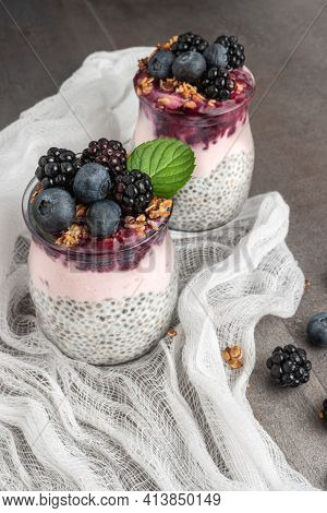 Chia Pudding Parfait With Blackberries And Blueberry Smoothie And Granola.