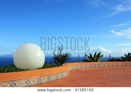 Big white ball and blue sky and sea scenery background