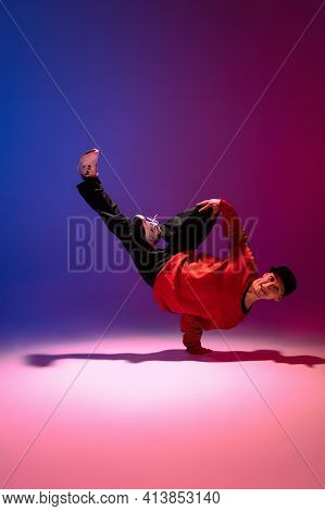 Beautiful Sportive Boy Dancing Hip-hop In Stylish Clothes On Colorful Gradient Background At Dance H