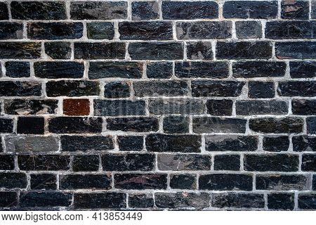 Background From A Carbon Black Brick Wall
