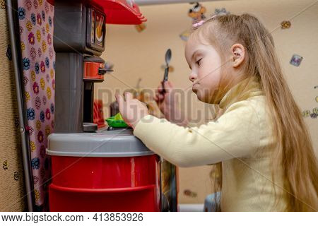 Development And Education Of A Child With Down Syndrome. A Game Of Cheating. A Girl With Down Syndro