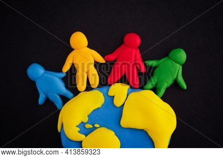 Group Of People Around The World. Scene Is Made Out Of Polymer Clay.