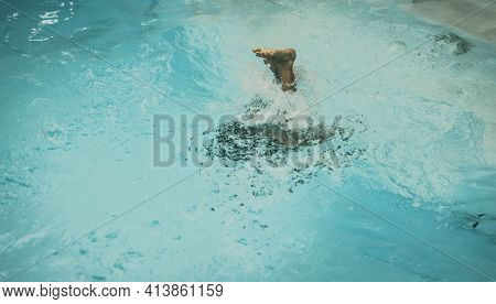 Photo From Above, Abstract Life Background. Unrecognizable Child Body Legs Heel Feet Under Pool Wate