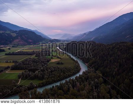 Aerial Sunset Panorama View Of River Bend With Green Meadow Fields Drau Valley At Stein Castle Alpin