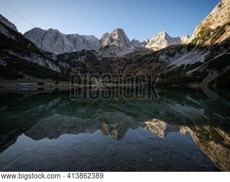 Seebensee Lake Mirror Reflection Of Autumn Fall Alpine Mountain Sunset Panorama In Ehrwald Tyrol, Au