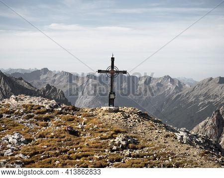 Autumn Fall Panorama Of Tajakopf Peak Summit Cross Alpine Mountain Landscape At Lake Seebensee In Eh