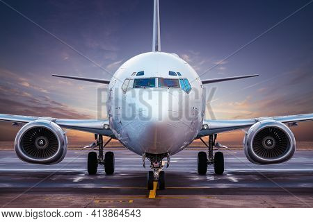 Modern Airplane At An Airfield While Sunset