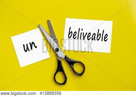 Scissors Cut The Word Unbelievable. Concept Believable. Cuts The Word Un. I Can, Goal Achievement, P