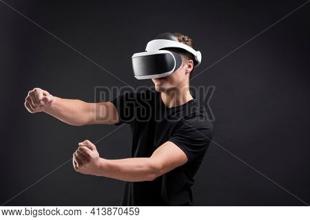 Man with VR playing racing game entertainment technology