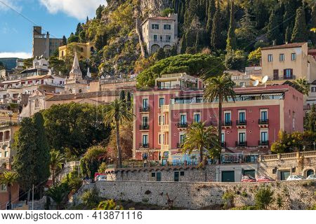 Cityscape of Taormina with historical buildings at sunny day, Sicily, Italy