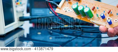 Debugging electronics device. PCB witch microcontroller in electronics laboratory