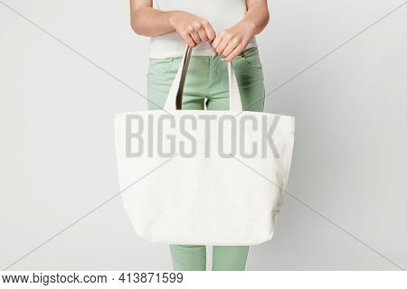 Woman with white tote bag