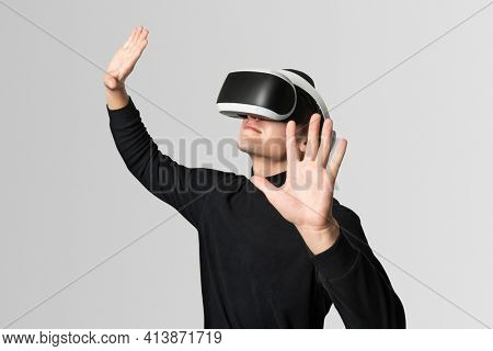 Man with VR headset touching invisible screen futuristic technology
