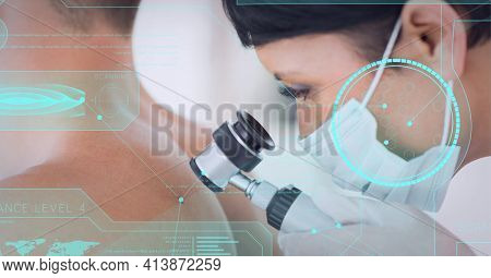 Medical data processing against female doctor wearing face mask examining back of male patient. medical research and technology concept