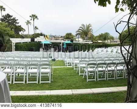 NEWPORT BEACH, CALIFORNIA - JULY 12, 2019: Workers setting up the outdoor Summer Concert Series area at the Hyatt Regency Newport Beach.