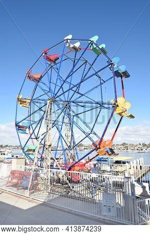 NEWPORT BEACH, CALIFORNIA - JANUARY 6, 2017: Fun Zone Ferris Wheel. Rebuilt in 1986 the Fun Zone , arcade, food shops, boutiques and ferris wheel are an area highlight.