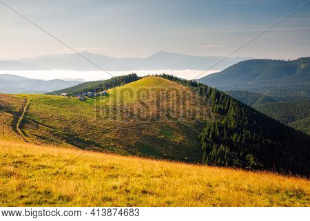 Splendid summer scene of a rolling hills on a sunny day. Mountains in morning light. Location place Carpathian, Ukraine, Europe. World landmarks. Vibrant photo wallpaper. Discover the beauty of earth.