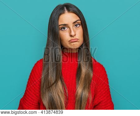 Beautiful hispanic woman wearing casual clothes looking sleepy and tired, exhausted for fatigue and hangover, lazy eyes in the morning.