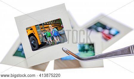 Photograph 35mm slide of unidentifiable school children boarding a schoolbus