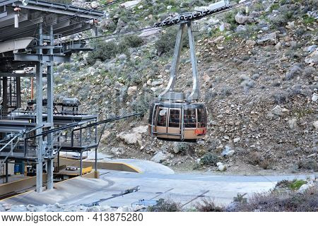 PALM SPRINGS, CA - FEBRUARY 24, 2015: Palm Springs Aerial Tramway Valley Station. A cabin full of tourists and hikers on the 2.5-mile ride from the Mountain Station arriving at the Valley Station.