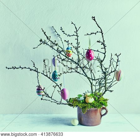 Easter tree with colorful Easter eggs. Natural Easter decoration