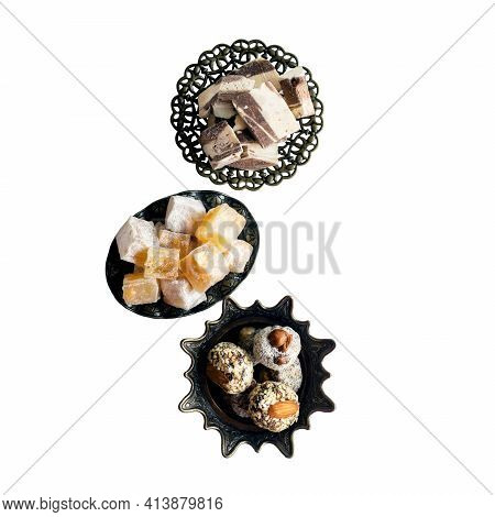 Oriental Sweets-hashtak, Turkish Delight And Halva In Traditional Oriental Dishes. Isolated On A Whi