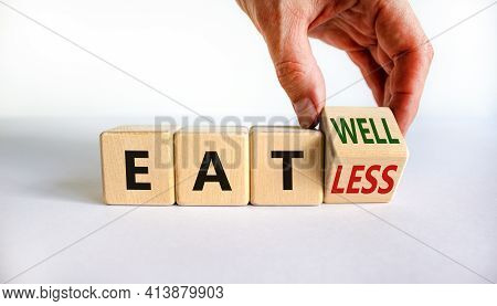 Eat Well Or Eat Less Symbol. Businessman Turns A Cube And Changes Words 'eat Less' To 'eat Well'. Be