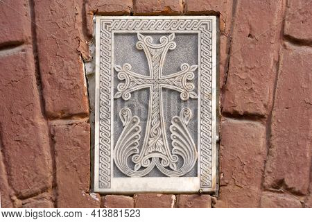 Armenian Christian Cross Carved In Stone. Ancient Ornamental Christian Cross On Stone In Church