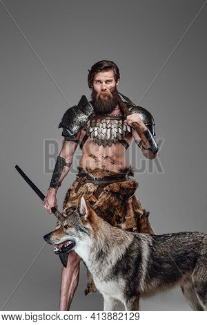 Authentic Grimy Viking Wearing Armor And His Beautiful Wolf