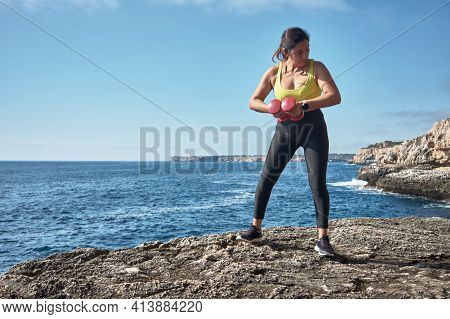 Fitness Woman In Sports Set Training With Elastic Band, Weights, Gym Exercises, In Front Of The Wate
